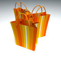 Bags orange shopping görad randig trio Royaltyfri Foto