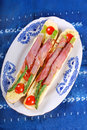 Baguette with green asparagus wrapped in ham baked prosciutto Royalty Free Stock Photography