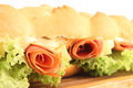 Baguette sandwich close up of a delicious and fresh on a with cold cuts lettuce ham and cheese breakfast or lunch Stock Images