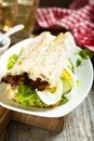 Baguette sandwich with fried bacon and eggs Royalty Free Stock Photo