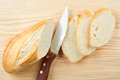 Baguette sliced on wooden board Stock Photo