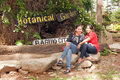Baguio city botanical garden two beautiful filipino women sit by the sign at philippines Stock Images
