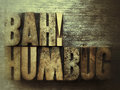 Bah humbug the words in old wood type on textured surface Royalty Free Stock Images