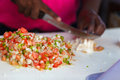 Bahamian conch salad close up of woman making traditional Stock Image