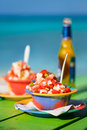 Bahamian conch salad two bowls of and bottle of beer Royalty Free Stock Image