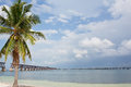 Bahia honda rail bridge overseas highway in the florida keys to the left with a palm tree and to the right Stock Photos