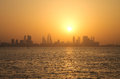 Bahrain skyline during sunset sea and Stock Photography