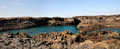Baia panoramic a natural bay formed by volcanic lava from past eruptions with natural arch surrounded by the blue waters of the Royalty Free Stock Photo