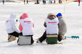 Baikal fishing yartsi russia april a team of fishers from the local political party women of buryatia sit around their ice hole Royalty Free Stock Photography