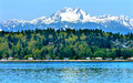 Bainbridge island puget sound snowy mt olympus washington mount snow mountains olympic national park state pacific northwest Royalty Free Stock Photo