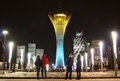 The baiterek astana in national colours winter nighttime view of tower capital of kazakhstan lit up of kazakh flag Stock Photo