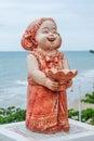 Bake clay doll holding tray Stock Photo