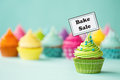 Bake sale cupcake with sign Royalty Free Stock Photos