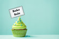 Bake sale cupcake with sign Stock Images