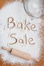 Bake sale poster flour on a wooden table symbolising a notice Stock Photo