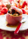 Baked apple stuffed with nuts and dried fruits Stock Image
