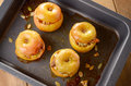 Baked apples homemade oven stuffed with pumpkin seeds and almond nuts in baking pan closeup Royalty Free Stock Photos