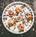 baked apples with nuts and honey a round baking tray on a wooden background, top view Royalty Free Stock Photo