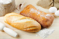 Baked baguette and bread on wooden board Royalty Free Stock Photography