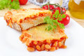 Baked beans on toast fresh bread with grated cheese and herbs Stock Photography