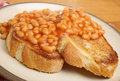 Baked beans on toast with visible steam rising Stock Photography