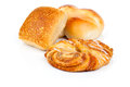 Baked bread bun and cinnamon rolls on white background Stock Image