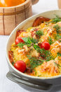 Baked cauliflower with tomato and vegetables and cheese Royalty Free Stock Image