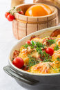 Baked cauliflower with tomato and vegetables and cheese Stock Photography