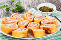 Baked cheese meat Roll-Ups on white dish, close-up Royalty Free Stock Photo