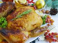 baked chicken fried whole delicious setting decoration dinner homemade cooked christmas white on a wooden background