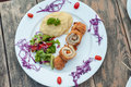 Baked chicken rolls with vegetable salad and mashed potato Royalty Free Stock Photo