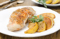 Baked chicken and saute quince with rosemary closeup on a plate Royalty Free Stock Image
