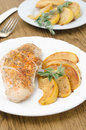 Baked chicken saute quince rosemary plate vertical Stock Photo