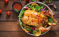 Baked chicken stuffed with rice for Christmas dinner on a festive table. Royalty Free Stock Photo