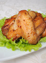 Baked chicken wings with garlic in honey and soy marinade Royalty Free Stock Photo