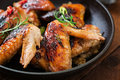 Baked chicken wings in pan.
