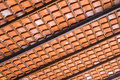 Baked clay roof tier on rusty iron bars Stock Photos