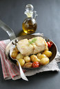 Baked cod fish with potatoes and vegetables Royalty Free Stock Photo