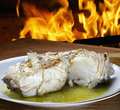 Baked cod with olive oil Royalty Free Stock Photo
