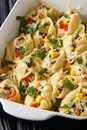 Baked conchiglioni pasta stuffed with chicken, mushrooms and veg Royalty Free Stock Photo