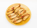 Baked cultivated bananas on dish Stock Images