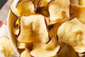 Baked dehydrated apples chips in a bowl Stock Photos