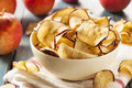 Baked dehydrated apples chips in a bowl Stock Images