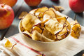 Baked dehydrated apples chips in a bowl Stock Photo