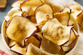 Baked dehydrated apples chips in a bowl Stock Photography