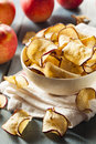 Baked dehydrated apples chips in a bowl Royalty Free Stock Image