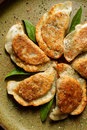 Baked dumplings filled with mushrooms and cabbage vegetarian dish tasty nutritious Royalty Free Stock Photos