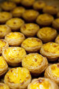 Baked egg tart on tray in row Stock Photos