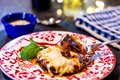 Baked Eggplant Parmagiana on red and white plate, gluten free - no egg or breadcrumbs. Royalty Free Stock Photo