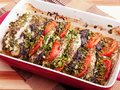 Baked eggplants with tomatos in a baking dish Royalty Free Stock Photos